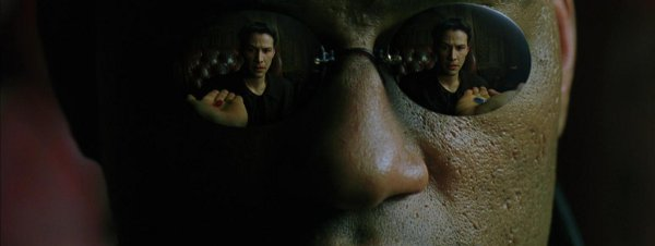 Morpheus Offers Neo a Red or Blue Pill