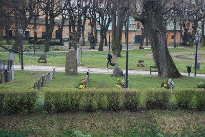 A person running through a graveyard